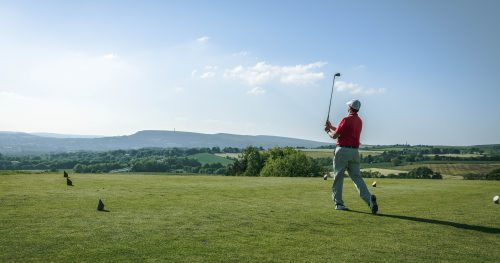 Golfer starting his game at Walmersley Golf Club