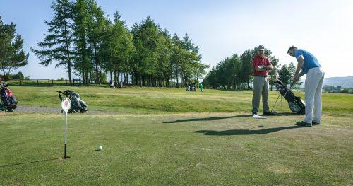 Golfer getting ready on the Walmersley Golf Course