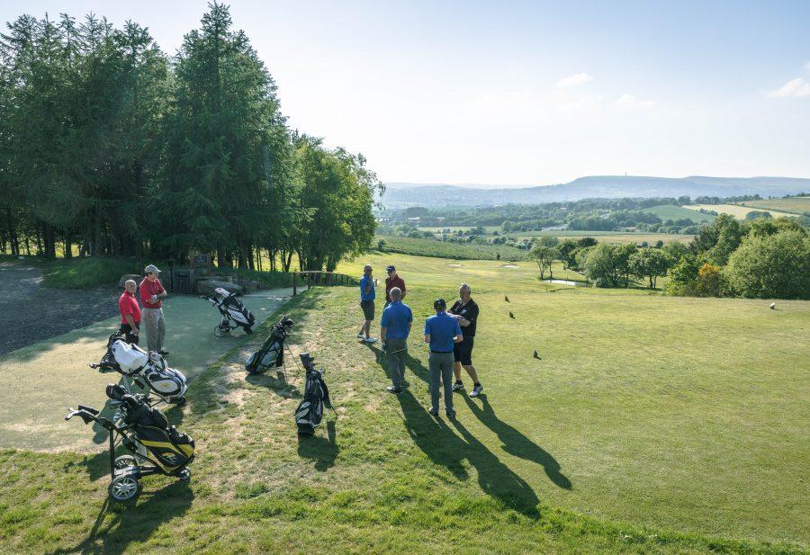 A group of golfers at Walmersley Golf Club