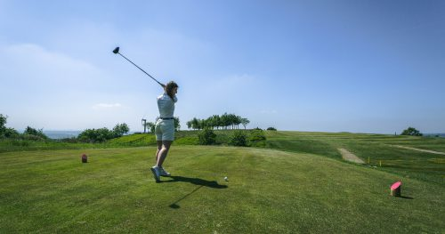 Junior golfer mid swing at Walmersley Golf Club