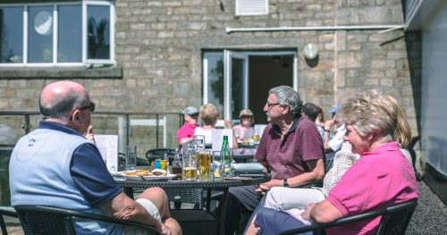 Visitors and members enjoying a drink at the clubhouse at Walmersley Golf Club